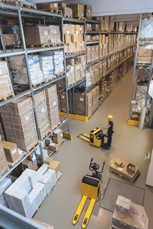 big warehouse with forklift and boxes