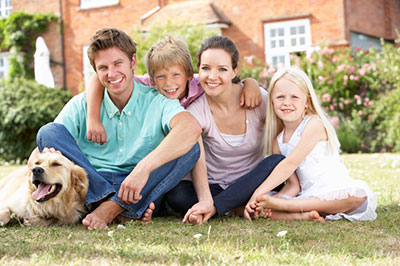 family together with dog and house background boy girl mom dad